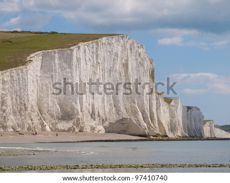 Rock beach and White Cliff at Seven Sisters Coast. - stock photo