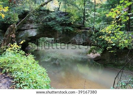 rock bridge over swift camp creek in the clifty wilderness of the red river gorge, kentucky - stock photo