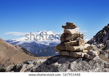 rock cairn and Mount Tronador in the mountains near Bariloche Argentina - stock photo