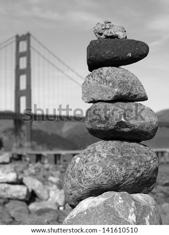 Rock cairn in front of the Golden Gate Bridge - stock photo