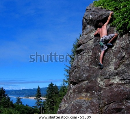 Rock climber at Patrick's Point State Park, CA - stock photo