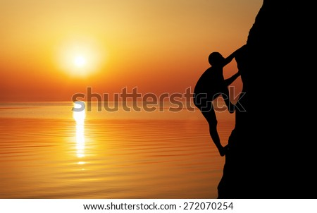 Rock climber at sunset background. Sport and active life  - stock photo