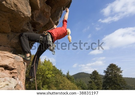 Rock climber Charlotte Frank at the Windstein - Vosges - France. - stock photo