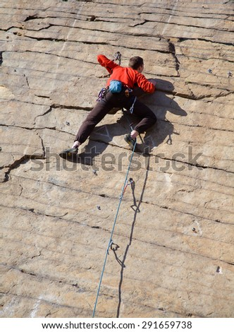 rock climber climbing an overhanging cliff