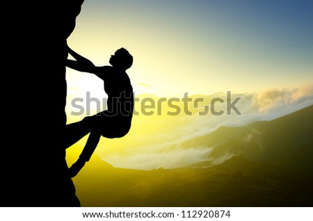 Rock climber on background of sundown. Sport and active life - stock photo