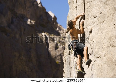 Rock Climber on Cliff Face - stock photo