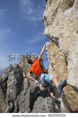 Rock climber to climb the wall.