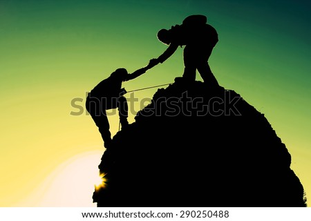 rock climbing helping hand - stock photo