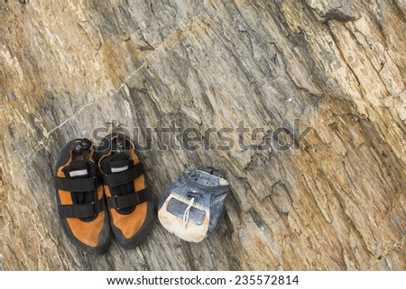 Rock Climbing shoes and magnesium bag - stock photo