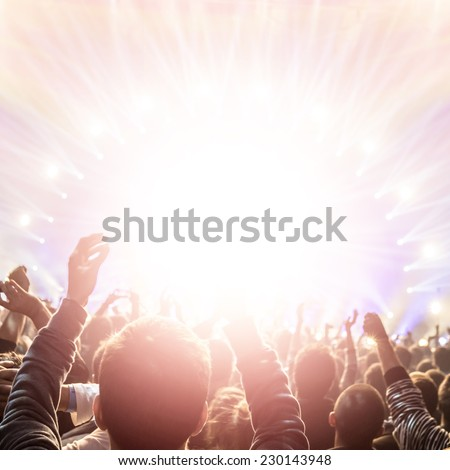 Rock concert, active lifestyle, happy people applauding to pop group, enjoying time in night club, new year celebration - stock photo
