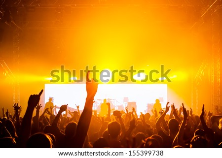 Rock concert, happy people silhouettes - stock photo