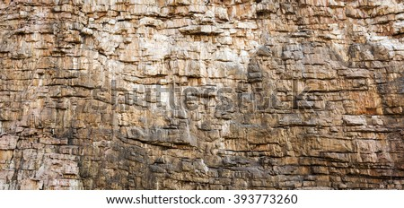 Rock face texture of large rocky cliffs - stock photo