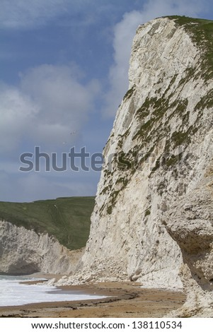 Rock fall from a chalk cliff onto the beach below at Durdle Door, Dorset, UK part of the World Heritage Jurassic Coast - stock photo