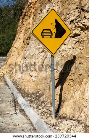 rock fall warning traffic sign on the highway - stock photo