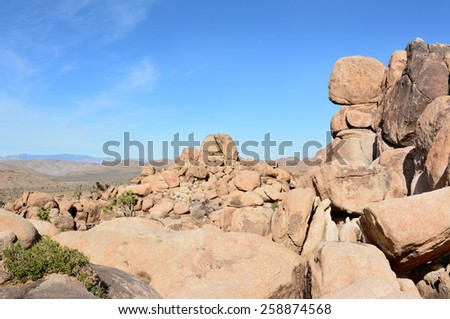 Rock formation at Joshua Tree National Park. The park attracts climbers and bouldering enthusiasts from around the world. - stock photo
