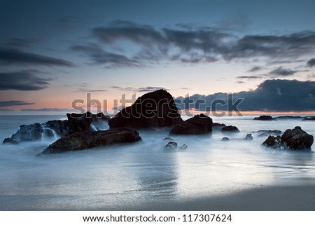 Rock formation at Woods Cove, Laguna Beach, California. A seascape of sea rock formation with a dramatic sky. This image was taken at Woods Cove, Laguna Beach in Southern California, USA. - stock photo