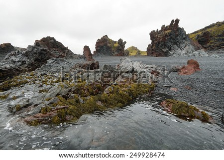 Rock formations in black sand beach of Djupalonssandur, Snaefellsnes peninsula, Iceland - stock photo