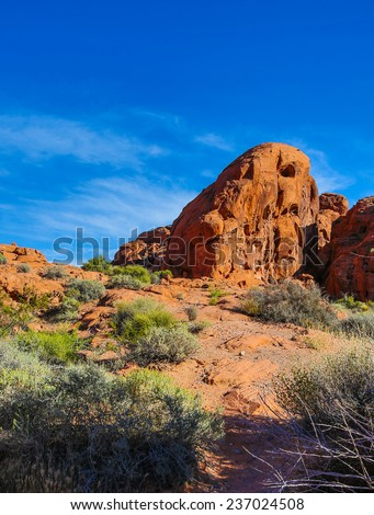 Rock formations in Valley of Fire in Nevada against blue sky. - stock photo