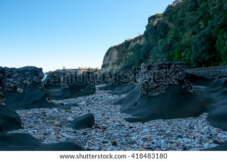 Rock formations on the beach - stock photo