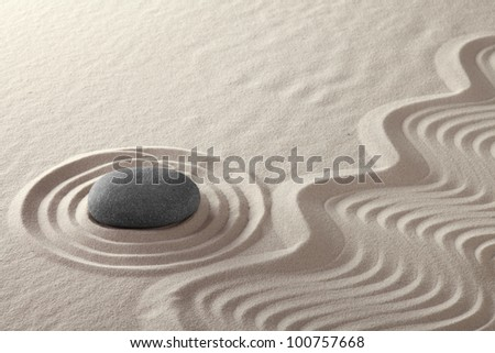 rock garden zen buddhism meditation stone and lines in sand Japanese culture concept for balance simplicity purity and concentration conceptual for spa and wellness background - stock photo