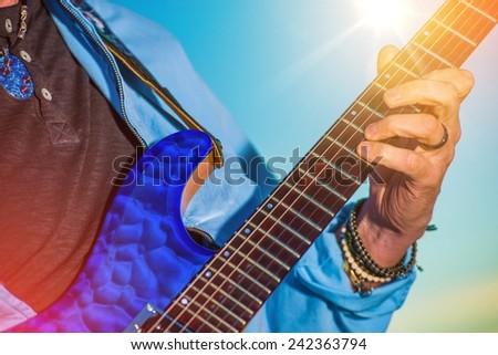 Rock Guitar Player. Men Playing Electric Guitar Closeup Photo. - stock photo