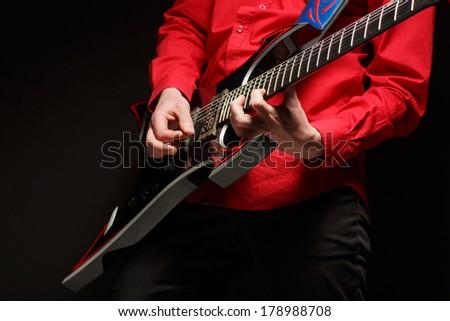 Rock guitarist plays solo guitar. - stock photo