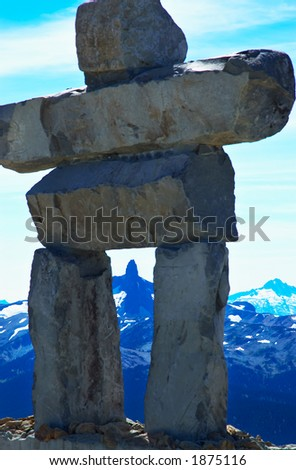 Rock human figure on top of Blackcomb Mountains - stock photo