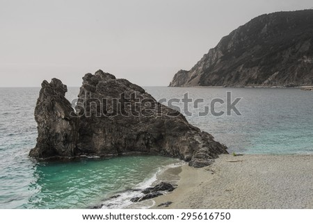 Rock in front of the coast of Monterosso al mare (Cinque terre) - scenic Ligurian coast, Italy - stock photo