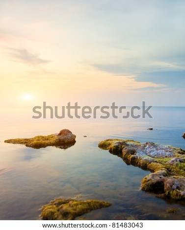 Rock in sea and blue sky. Nature composition. - stock photo
