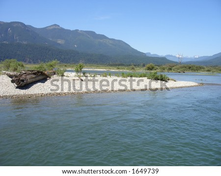 Rock island in a River - stock photo