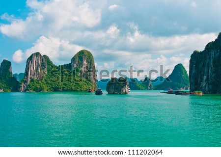 Rock islands in Halong Bay, Vietnam, Southeast Asia - stock photo