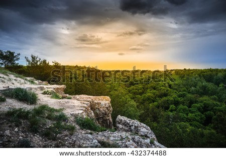 Rock ledge in the wooded mountains at sunrise