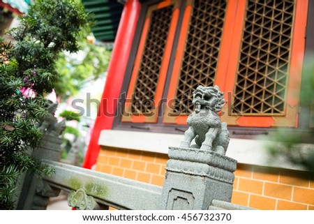 Rock Lion in chinese temple - stock photo