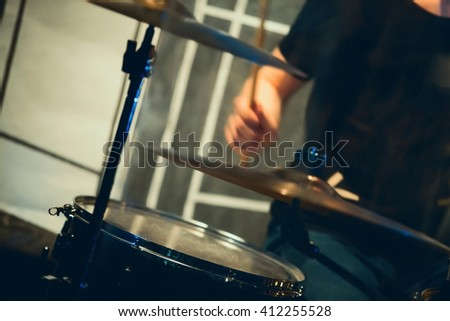 Rock music blurred background, drummer on a stage. Vintage tonal correction photo filter  - stock photo