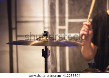 Rock music blurred background, drummer plays on cymbal. Vintage tonal correction photo filter, selective focus, motion blur effect - stock photo