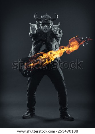 Rock musician in scary masks emotionally gesticulates hands. - stock photo