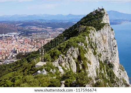 Rock of Gibraltar next to the La Linea town in Spain and Mediterranean Sea. - stock photo