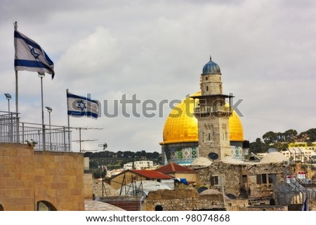Rock of the Dome and two Israeli flags - stock photo