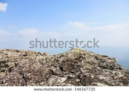 Rock on sky background - stock photo