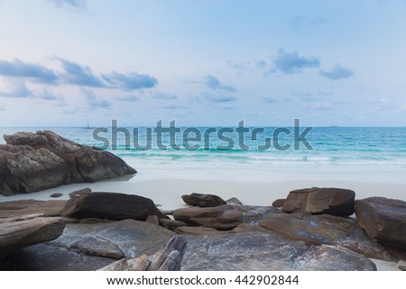 Rock on the beach with clear blue sky, natural landscape background - stock photo