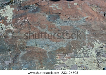 Rock paintings from the Bronze Age - stock photo