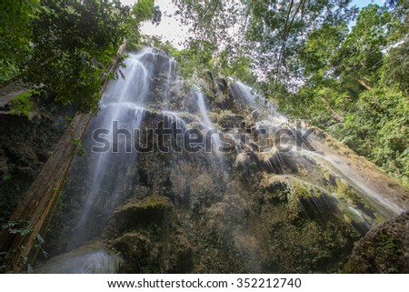 Rock, pool and waterfall in Oslob, Philippines. - stock photo