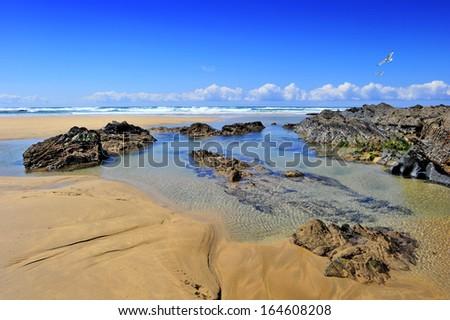 Rock pool at Treyarnon Bay in North Cornwall, England - stock photo