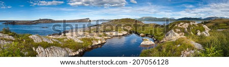 Rock pools and mountain fjords running alongside the Atlantic road in Norway. - stock photo