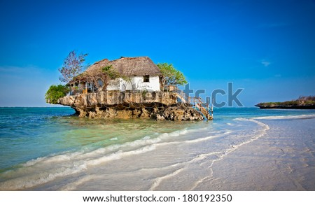 Rock Restaurant over the sea in Zanzibar, Tanzania, Afrika. - stock photo