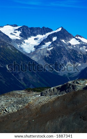 Rock, river, valley, and snow peaks of Blackcomb Mountains. More with keyword group14l  - stock photo