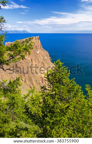 Rock Shamanka at headland Burhan on island Olkhon, lake Baikal, photographed in clear solar weather.