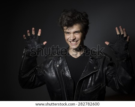 Rock singer in the leafer jucket - stock photo