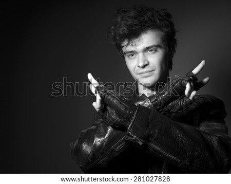 Rock singer in the leather jacket - stock photo