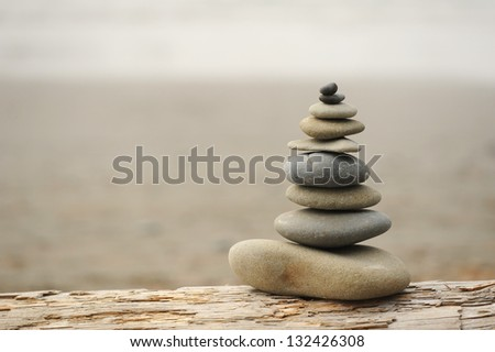 Rock Stacking on a large piece of driftwood along the Washington Coast.